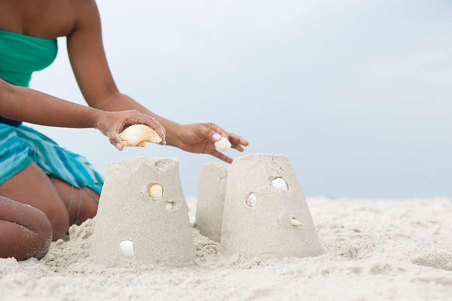 building sandcastles on beach