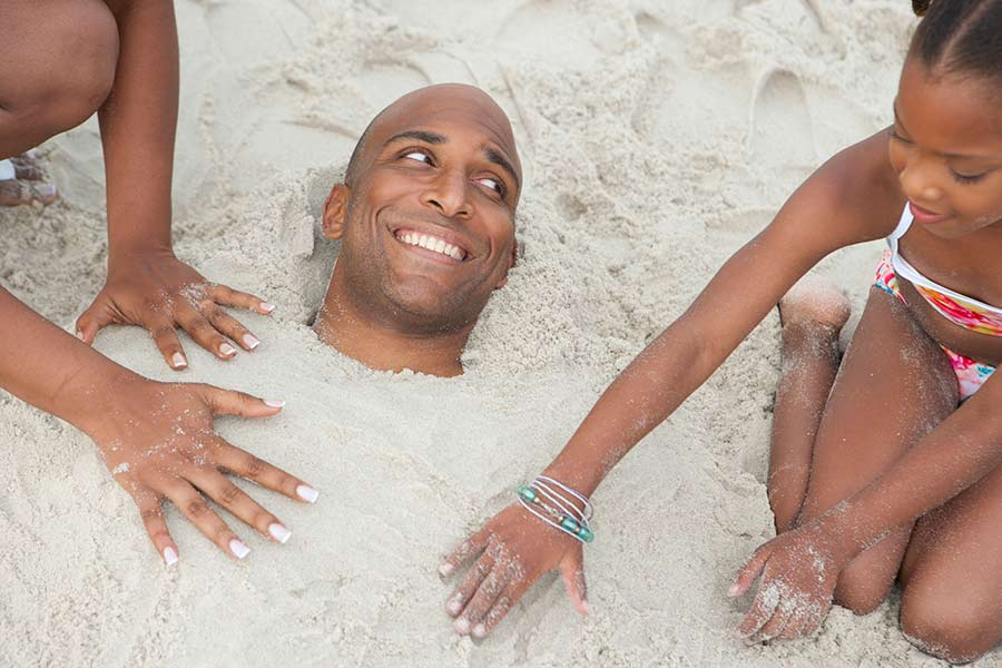 burying dad in sand