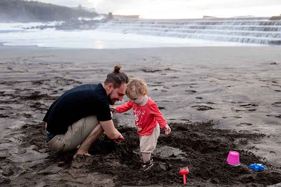 Father-Daughter playing at beach