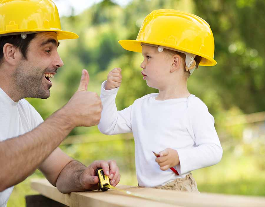 dad and son building together