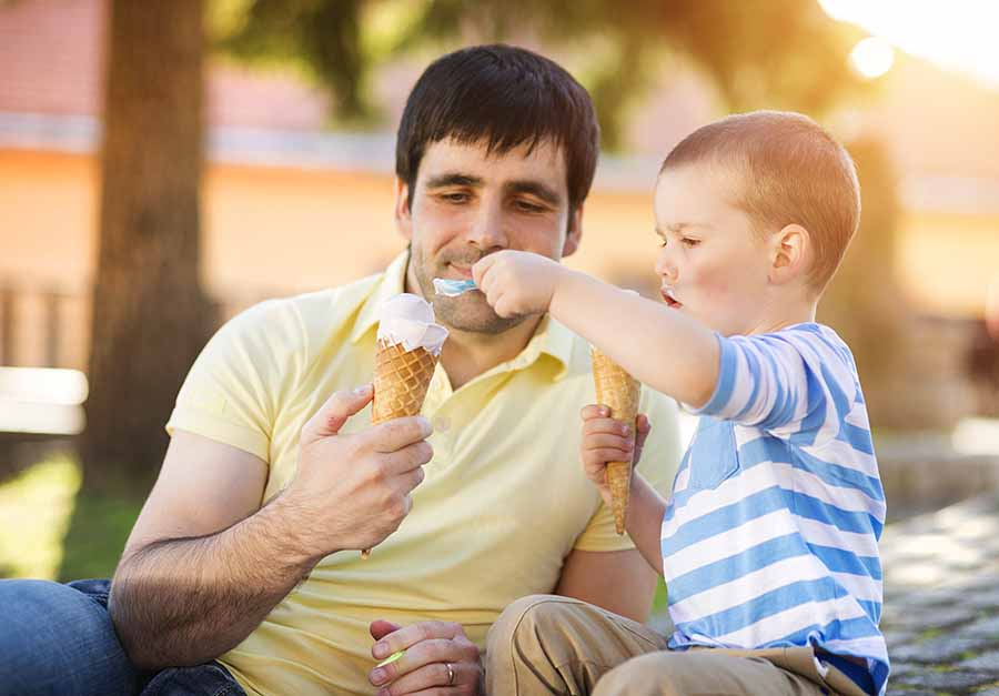 dad and son eating ice cream