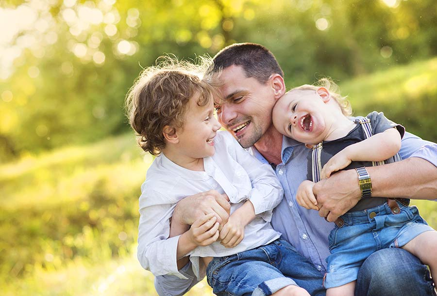 Dad and sons having fun