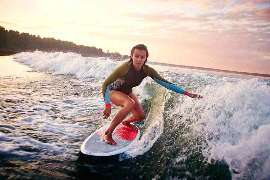 girl surfing at the beach