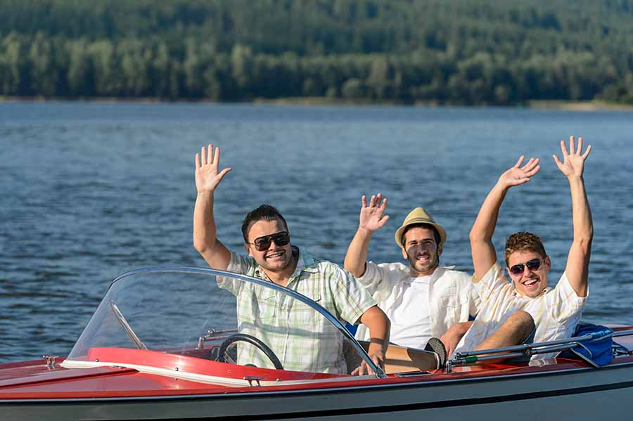 dad and sons in boat