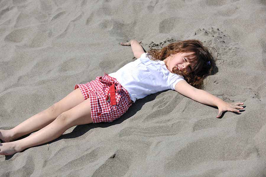 daughter playing in sand