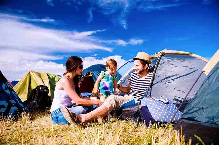 family with kids camping together