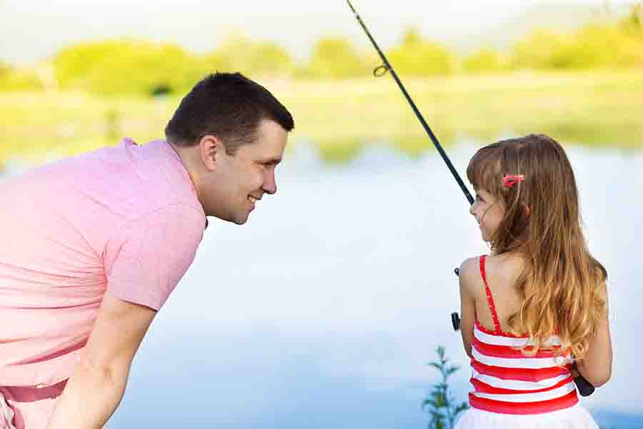 dad fishing with young daughter