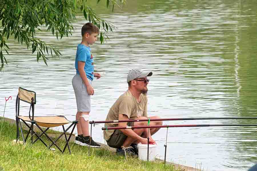 dad and kid fishing on river