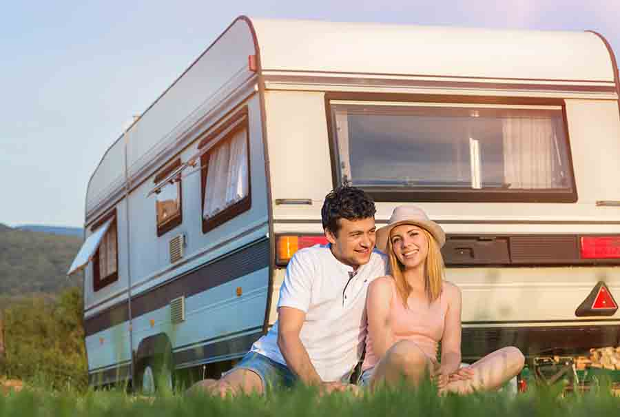 couple in front of camper