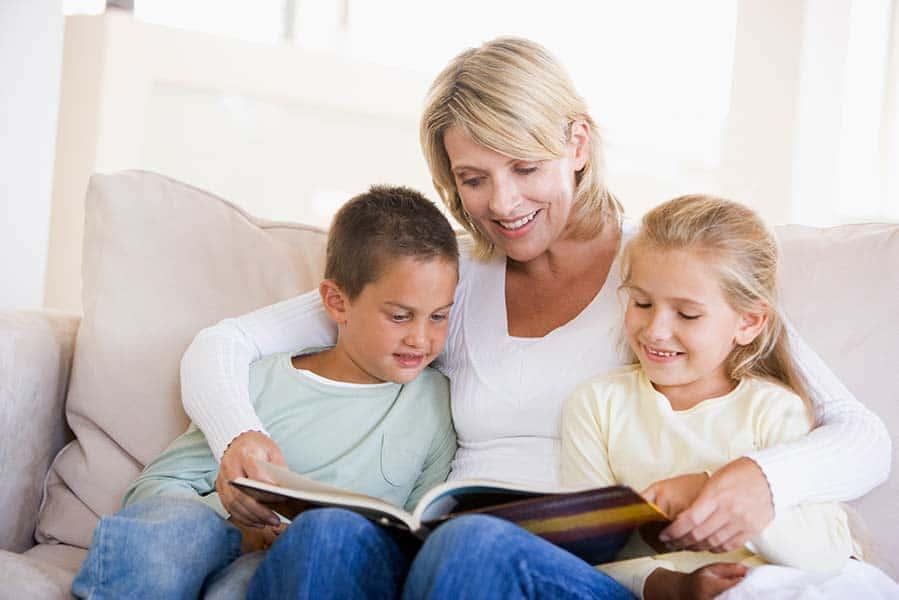 parent reading books to kids