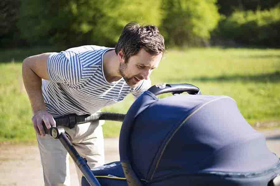 parent push child in stroller