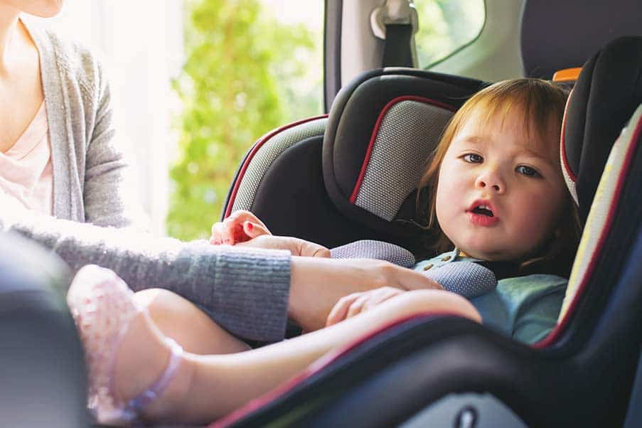 toddler in car with parent